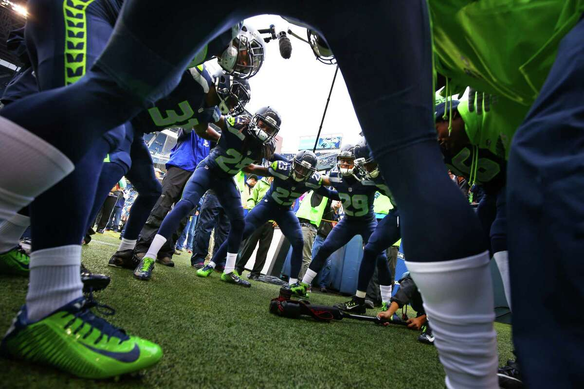 The Legion of Boom huddles before the Seahawks game against the Panthers, Sunday, October 18, 2015.