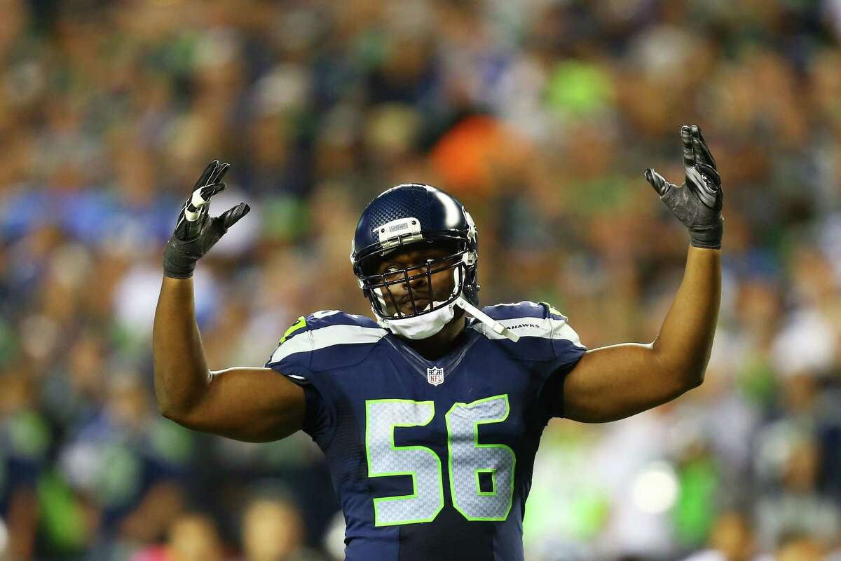 Cliff Avril motions to the crowd in the second half of Monday night's game against the Detroit Lions, October 5, 2015.