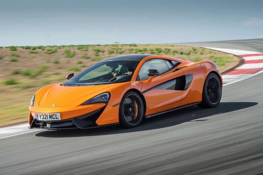 Mclaren luxury sports cars zoom into houston houston for Dean motor cars houston tx