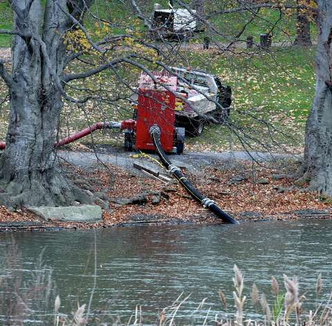 Washington Park Lake is drained to aid in the search for a knife that police believe was used in the killing of Jacquelyn Porreca Thursday afternoon, Nov. 19, 2015, in Albany, N.Y. (Skip Dickstein/Times Union) Photo: SKIP DICKSTEIN