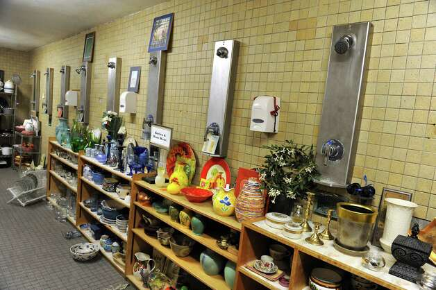 Donated goods are seen in the men's shower at the Grassroots Givers headquarters on Wednesday, Nov. 18, 2015 in Albany, N.Y. The building used to house the Albany YMCA. (Lori Van Buren / Times Union) Photo: Lori Van Buren / 10034304A