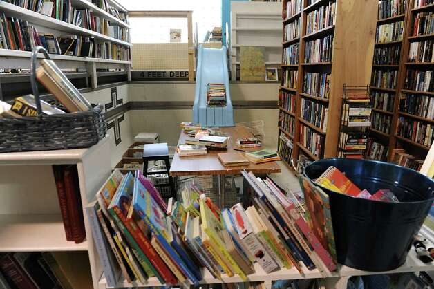 Donated books are seen at the Grassroots Givers headquarters on Wednesday, Nov. 18, 2015 in Albany, N.Y. The building used to house the Albany YMCA. (Lori Van Buren / Times Union) Photo: Lori Van Buren / 10034304A