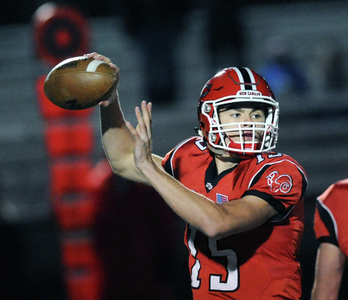 New Canaan quarterback Michael Collins (#15) during the high school football game between New Canaan High School and Fairfield Ludlowe High School at New Canaan, Conn., Friday night, Nov. 13, 2015.