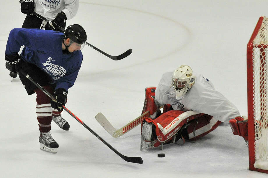 FILE PHOTO: Evansville Icemen goalie Alex Vazzano blocks the shot from Strasbourg's Kevin Sullivan during the seventh annual Big Assist benefiting the Obie Harrington-Howes Foundation at Terry Conners Rink in Stamford, Conn., on Wednesday, July 15, 2015. Photo: Jason Rearick / Hearst Connecticut Media / Stamford Advocate