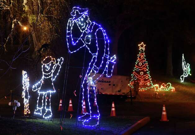 A police officer is part of the display during the 19th annual Price Chopper Capital Holiday Lights in the Park on Thursday, Nov. 19, 2015, at Washington Park in Albany, N.Y. Hours are Sundays through Thursdays from 6 to 9 p.m. and Fridays and Saturdays from 6 to 10 p.m. (Cindy Schultz / Times Union) Photo: Cindy Schultz / 00034235A
