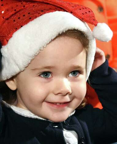 Charlotte Brooks, 2, of Saratoga Springs waits to greet Santa during the 19th annual Price Chopper Capital Holiday Lights in the Park on Thursday, Nov. 19, 2015, at Washington Park in Albany, N.Y. Hours are Sundays through Thursdays from 6 to 9 p.m. and Fridays and Saturdays from 6 to 10 p.m. (Cindy Schultz / Times Union) Photo: Cindy Schultz / 00034235A