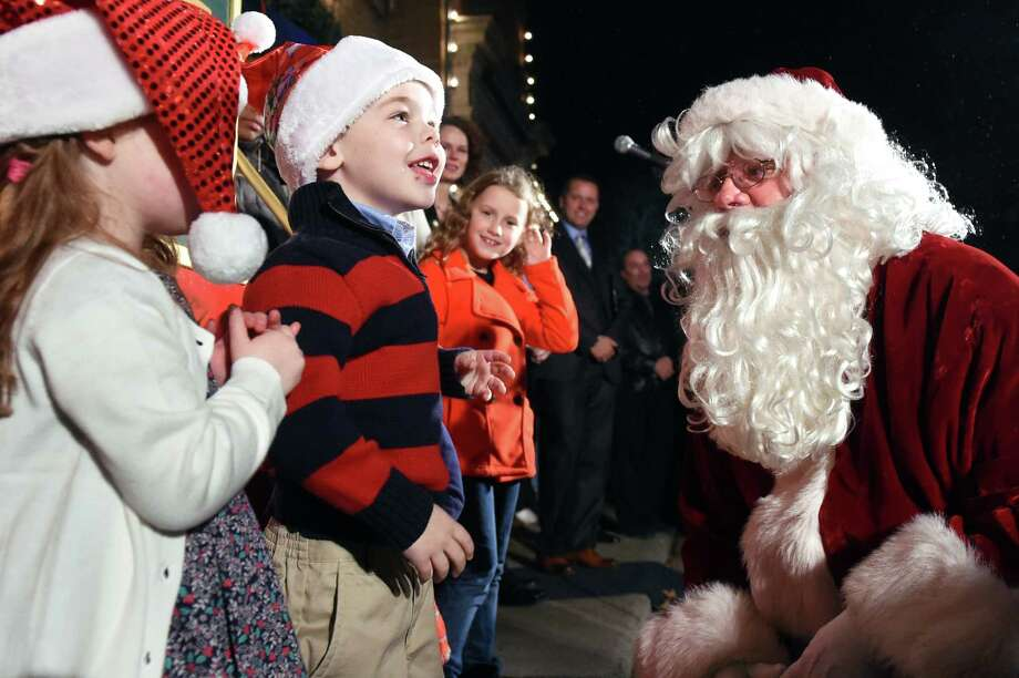 Thomas Brooks, 4, of Saratoga Springs, center, greets Santa during the 19th annual Price Chopper Capital Holiday Lights in the Park on Thursday, Nov. 19, 2015, at Washington Park in Albany, N.Y. Hours are Sundays through Thursdays from 6 to 9 p.m. and Fridays and Saturdays from 6 to 10 p.m. (Cindy Schultz / Times Union) Photo: Cindy Schultz / 00034235A
