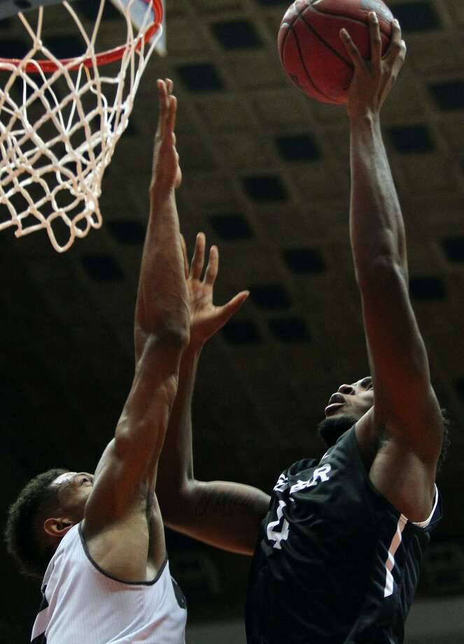 Butler forward Tyler Wideman (right) goes to the basket against Missouri State forward Obediah Church during the Puerto Rico Tip-Off in San Juan. Photo: Ricardo Arduengo, Associated Press