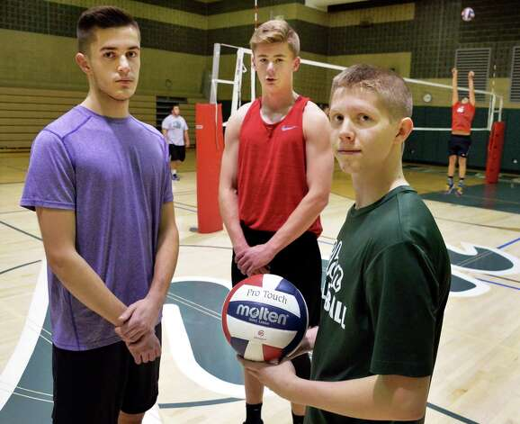 Shenendehowa volleyball players Mitchell DeBortoli, left, Sean Dillon and Tom Hurley, right, during practice Thursday Nov. 19. 2015 in Clifton Park, NY.  (John Carl D'Annibale / Times Union) Photo: John Carl D'Annibale / 10034331A