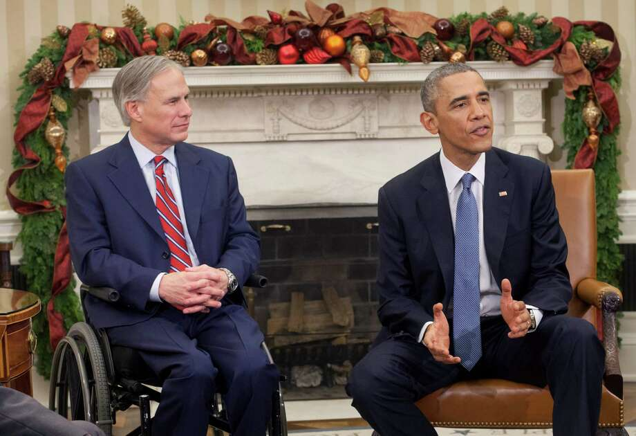 President Barack Obama, right, meets with newly elected governors in the Oval Office of the White House in Washington, Friday, Dec. 5, 2014. Sitting next to Obama is Texas Gov.-elect Greg Abbott, left. (AP Photo/Pablo Martinez Monsivais) Photo: Pablo Martinez Monsivais, STF / AP