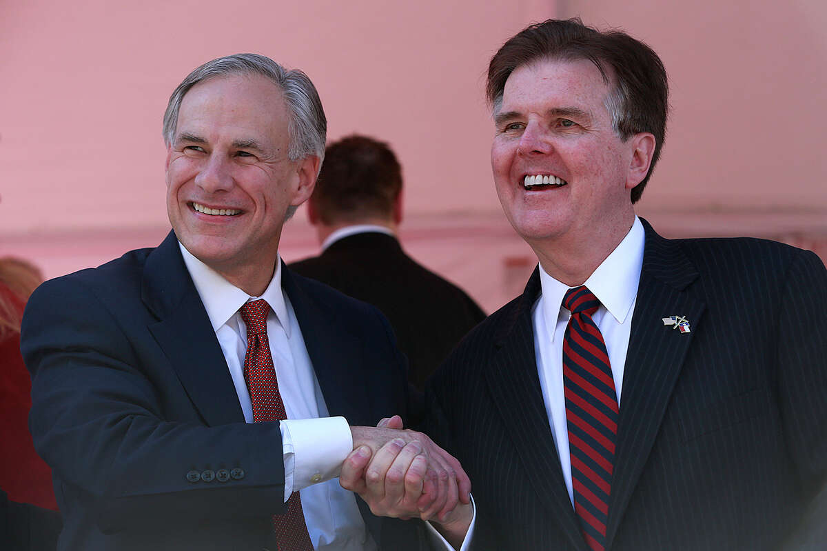 """Lt. Gov. Dan Patrick (right) seen with Gov. Greg Abbott, on Jan. 20, wrote """"Wake up, Mr. President!"""" on Facebook regarding a report that two Syrian families had tried to enter the country at the Texas-Mexico border."""