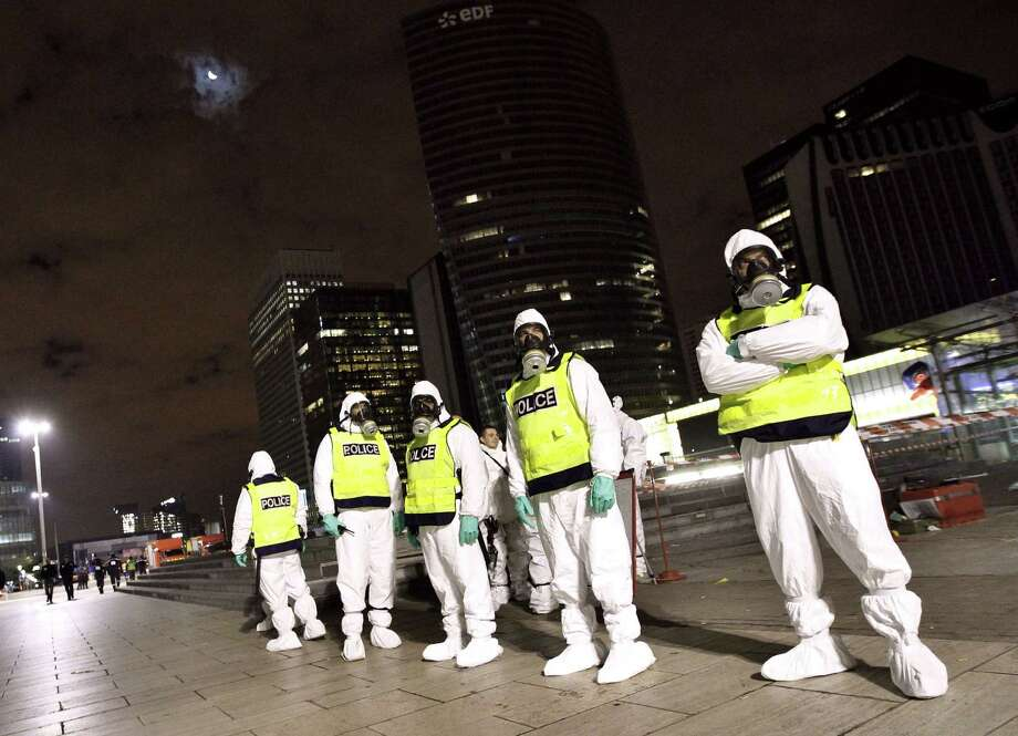"(FILES) - A picture taken on November 19, 2011 at La Defense near Paris shows French policemen wearing NBCR suits (Nuclear, Bacteriological, Chemical) participating in a simulation exercise of a bacteriological contamination. Prime Minister Manuel Valls warned on November 19, 2015 of the danger of an attack in France using ""chemical or biological weapons"", in a speech to lawmakers debating the extension of a state of emergency. ""We must not rule anything out,"" Valls said. ""There is also the risk from chemical or biological weapons,"" he added.
