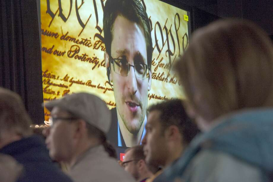 Edward  Snowden, the former National Security Agency contractor, speaks on  screen during a virtual conversation at a featured session at the South  By Southwest (SXSW) Interactive Festival in Austin, Texas, in 2014.  Drawing a line from Snowden to the Paris tragedy is problematic,  according to some analysts, because even two years after the leaks it is  difficult to isolate the extent to which they caused terrorist networks  to change the way they communicate. Photo: David Paul Morris, Bloomberg News
