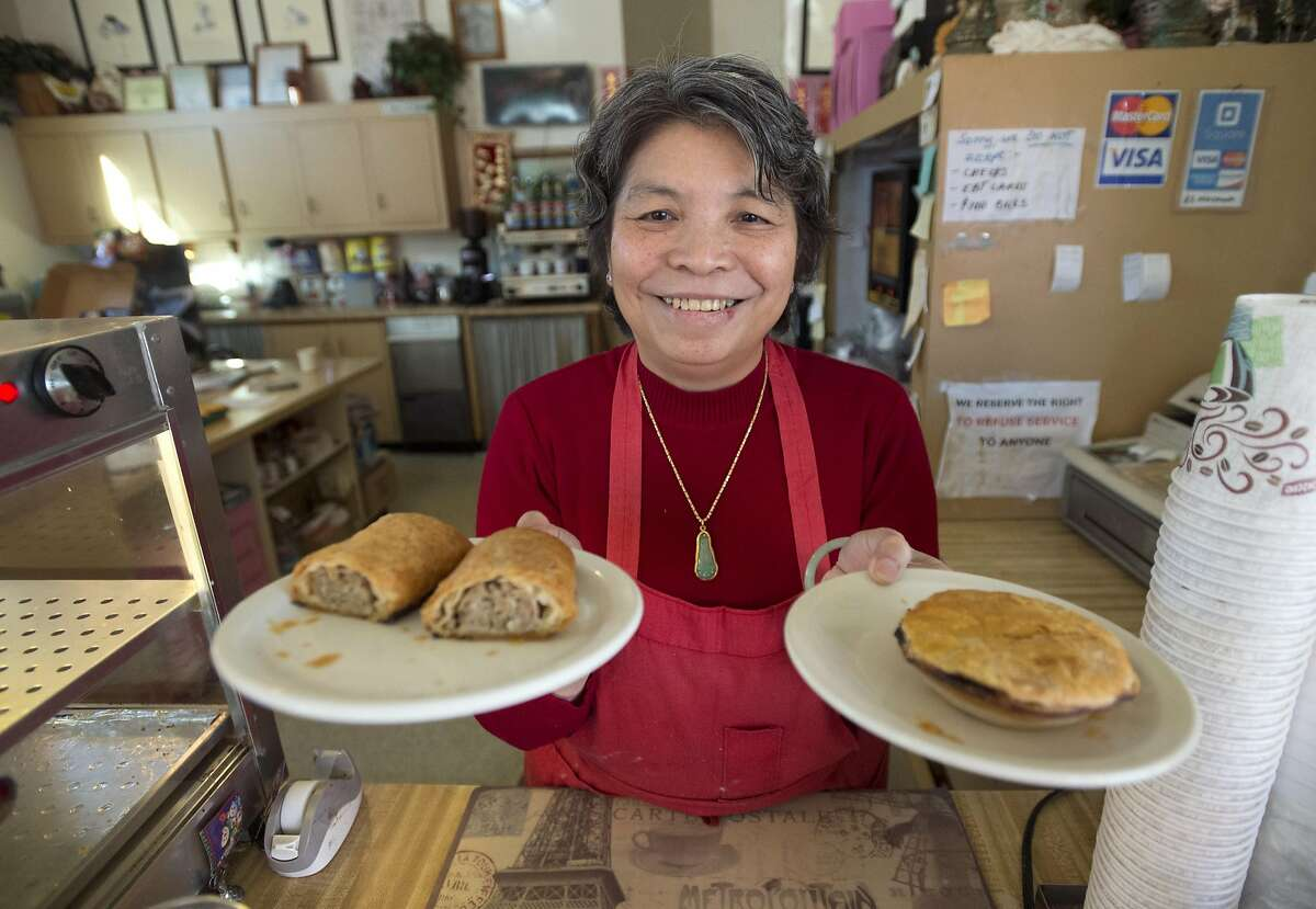 Co-owner and baker, Mary Chan, displays her Australian meat pies at her shop Great Donuts & Cafe in Vallejo, California on November 19, 2015.