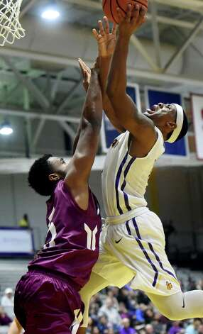 UAlbany's Evan Singletary, right, runs into the defense of Colgate's Malcolm Regisford during their basketball game on Thursday, Nov. 19, 2015, at SEFCU Arena in Albany, N.Y. (Cindy Schultz / Times Union) Photo: Cindy Schultz / 00034275A