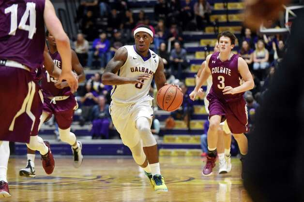 UAlbany's Evan Singletary, center, drives up court during their basketball game against Colgate on Thursday, Nov. 19, 2015, at SEFCU Arena in Albany, N.Y. (Cindy Schultz / Times Union) Photo: Cindy Schultz / 00034275A