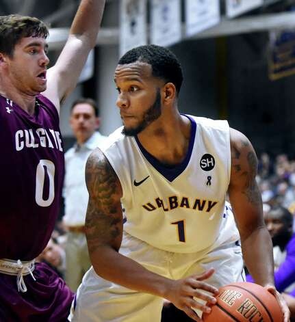 UAlbany's Ray Sanders, right, controls the ball as Colgate's Sean O'Brien defends during their basketball game on Thursday, Nov. 19, 2015, at SEFCU Arena in Albany, N.Y. (Cindy Schultz / Times Union) Photo: Cindy Schultz / 00034275A