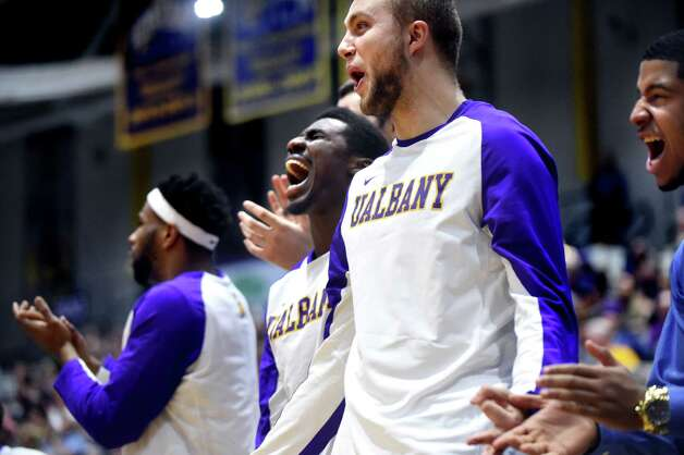 UAlbany's bench celebrates a play during their basketball game against Colgate on Thursday, Nov. 19, 2015, at SEFCU Arena in Albany, N.Y. (Cindy Schultz / Times Union) Photo: Cindy Schultz / 00034275A
