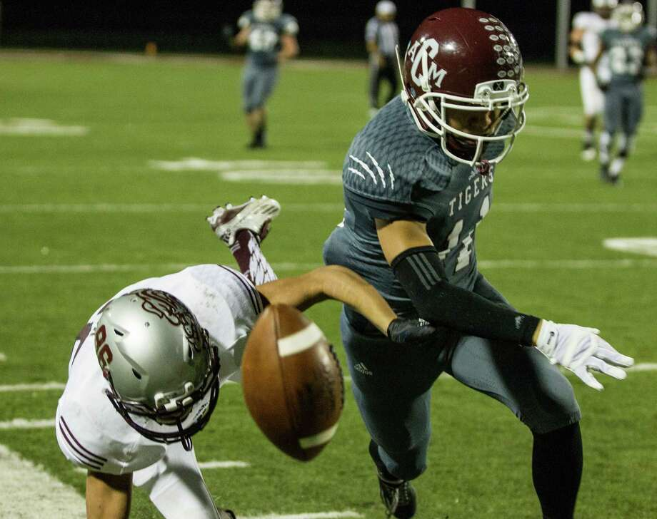 A&M Consolidated's David Gan breaks up a pass intended for Magnolia receiver Hunter Cork (86) during the second quarter of a Class 5A Division II Area playoff football game at Waller ISD Stadium on Thursday, Nov. 19, 2015, in Waller. Photo: Brett Coomer, Houston Chronicle / © 2015  Houston Chronicle