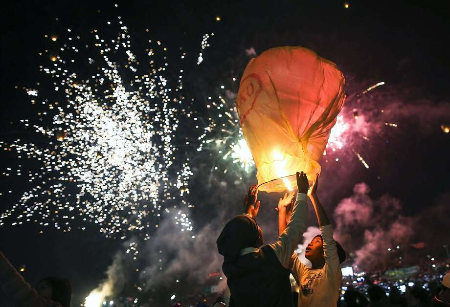 Young participants prepare to release a hot-air balloon during the Tazaungdaing Lighting Festival at Taunggyi in Myanmar's northeastern Shan State. Every year in November as the full moon approaches, tens of thousands of people from all over the country gather in Taunggyi for the colourful hot-air balloons festival during which balloons lift fireworks or lanterns which illuminate the sky at night while balloons of all shapes are flown during the day. Photo: Ye Aung Thu, AFP / Getty Images