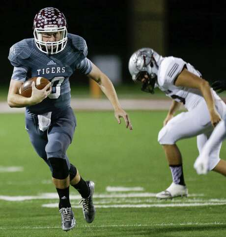 A&M Consolidated quarterback Mason Hickson (10) runs out of the pocket against Magnolia during the first quarter. Photo: Brett Coomer, Staff / © 2015  Houston Chronicle