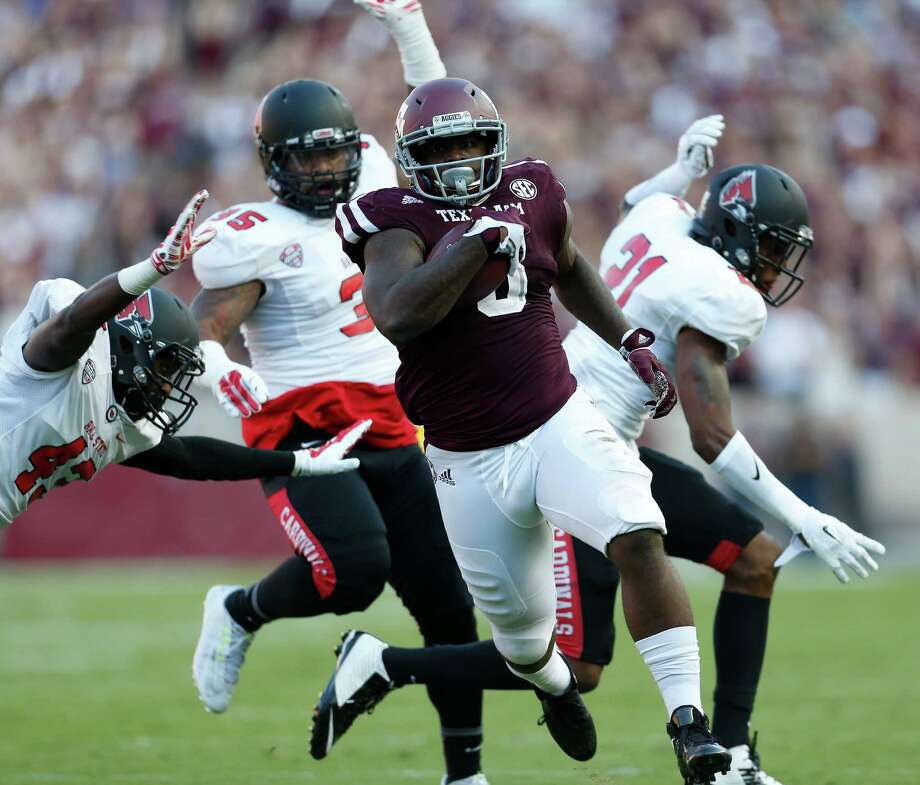 Aggies running back Tra Carson has a chance to become the 11th Aggie to reach 1,000 yards in a season. He's at 864 with two regular-season games remaining. Photo: Karen Warren, Staff / © 2015 Houston Chronicle