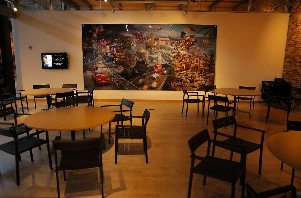 Artwork From Their Movie Cars Hangs On The Wall Of A Dining Room At Headquarters