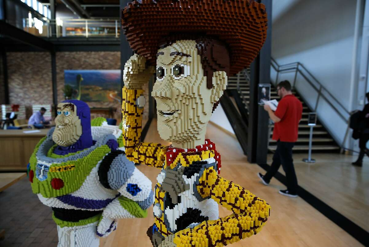 Buzz Lightyear and Woody from Toy Story greet visitors at the entrance to the Steve Jobs building at the headquarters of the Pixar Animation Studios in Emeryville, Calif., on Thurs. November 19, 2015.