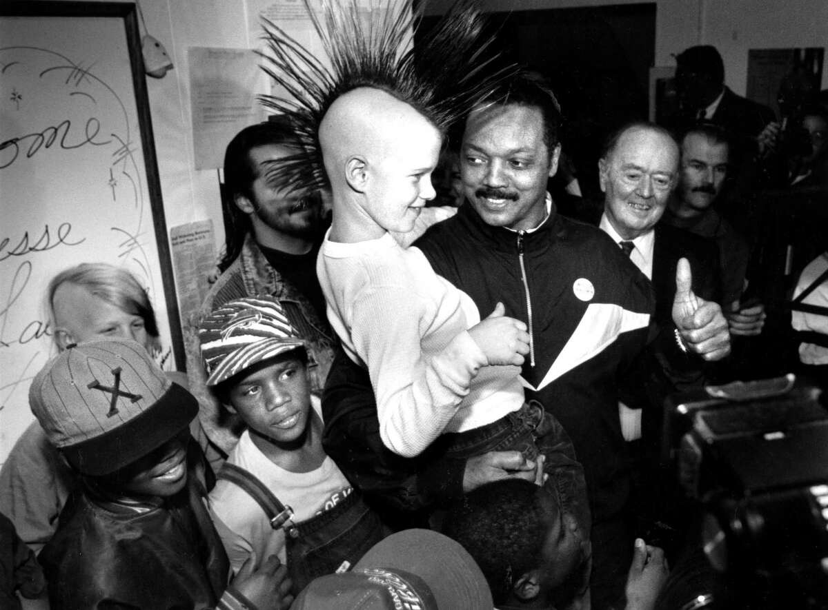 Jesse Jackson visits a shelter in the Haight Ashbury, 1992. Travis Vinson in Mohawk.