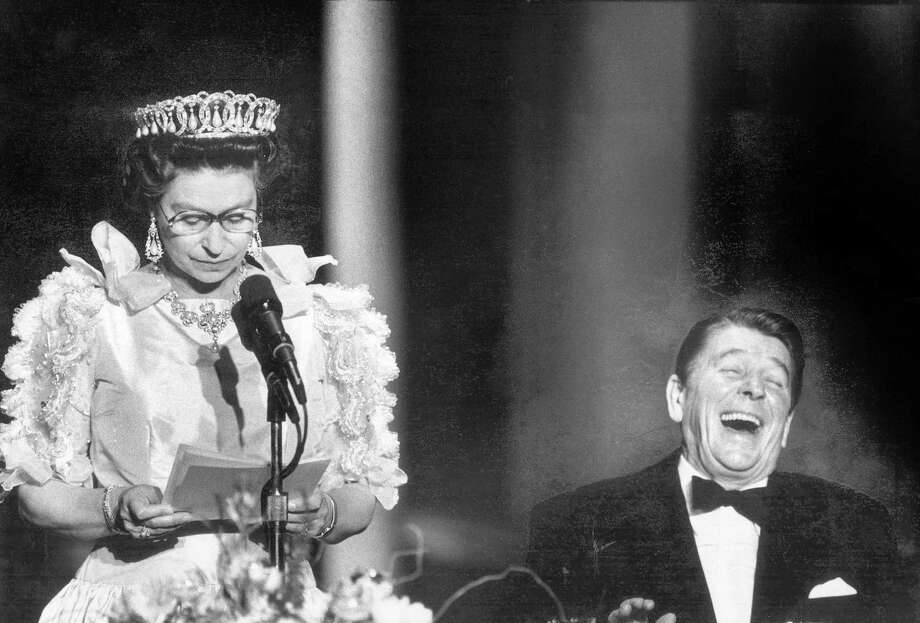 President Ronald Reagan laughs at a joke made by Queen Elizabeth II during a state dinner at the de Young Museum, March 3, 1983. Photo: Steve Ringman / The Chronicle / ONLINE_YES