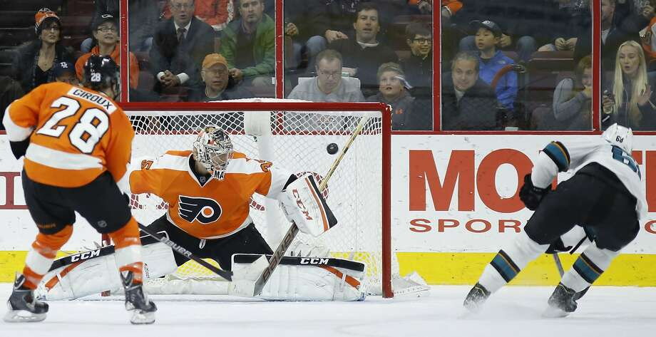Melker Karlsson firest a shot past Flyers goalie Steve Mason in overtime to give the Sharks their fifth consecutive road win. Photo: Matt Slocum, Associated Press
