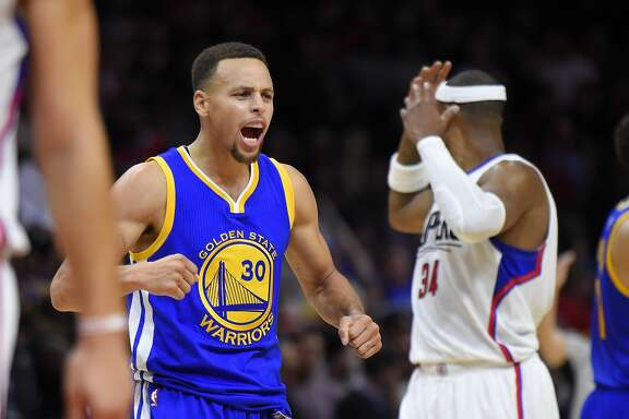 Golden State Warriors guard Stephen Curry, left, celebrates near Los Angeles Clippers forward Paul Pierce during the second half of an NBA basketball game, Thursday, Nov. 19, 2015, in Los Angeles. The Warriors won 124-117. (AP Photo/Mark J. Terrill)
