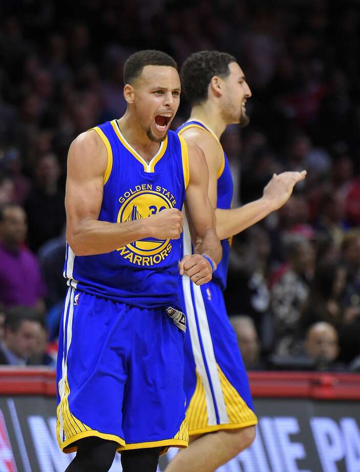 Stephen Curry, who had 40 points, celebrates with Klay Thompson in the second half of the Warriors' comeback. Photo: Mark J. Terrill, Associated Press