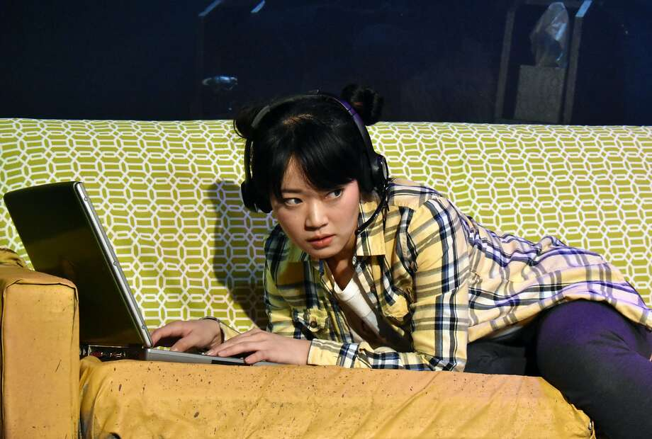 """Evie (Monica Ho) almost gets caught playing World of Warcraft by her boyfriend in Custom Made's """"In Love and Warcraft"""" Photo: Jay Yamada"""