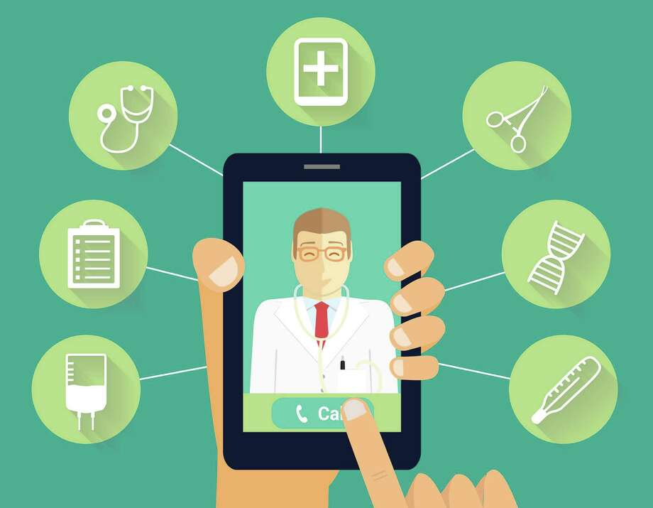 Call to doctor concept. Hand holds phone with smiling doctor. Photo: Alkov - Fotolia / alkov - Fotolia