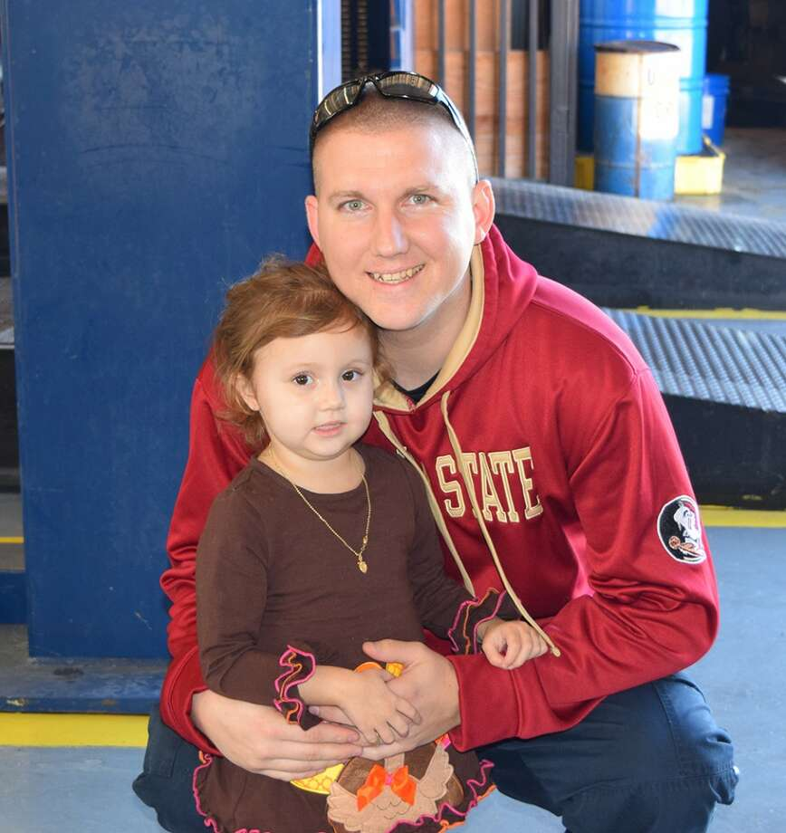 Dep. Ryan Matacale and his 2-year-old daughter, Haley, who recently had to undergo a liver transplant.