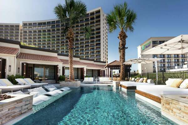 A gain in leisure and hospitality jobs helped offset losses in the oil sector in October, as Texas employers added 20,000 jobs. (San Luis Resort photo)
