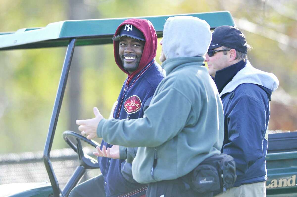 CHEERS FROM AN ALUM Former Kings School star and current Washington Redskins running back Silas Redd smiles with trainer Jason Bouton during the last football game of the season at King.
