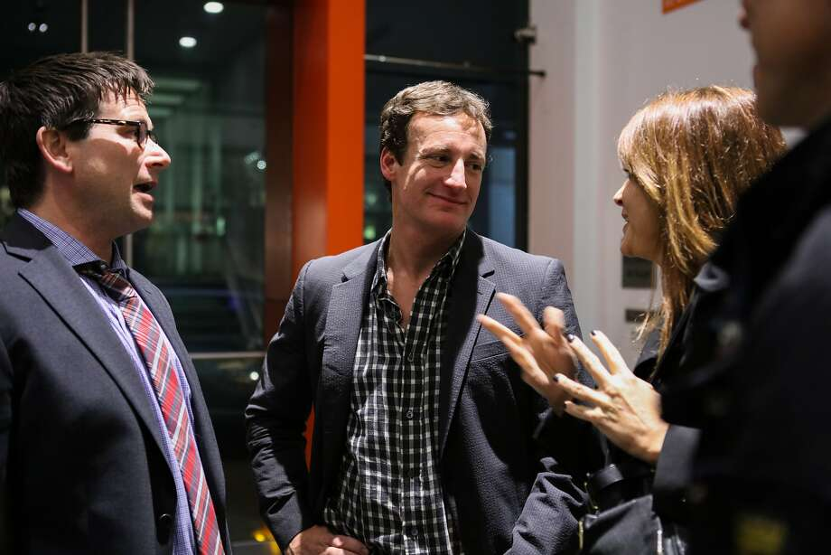 """Film producer Todd Traina (center) chats with friends Chris Lytton (left) and Julie Costanzo (right) at the reception following a special screening of """"Secret in their Eyes"""" at the New People Theatre in San Francisco, California on Thursday, November 19, 2015. Photo: Gabrielle Lurie, Special To The Chronicle"""