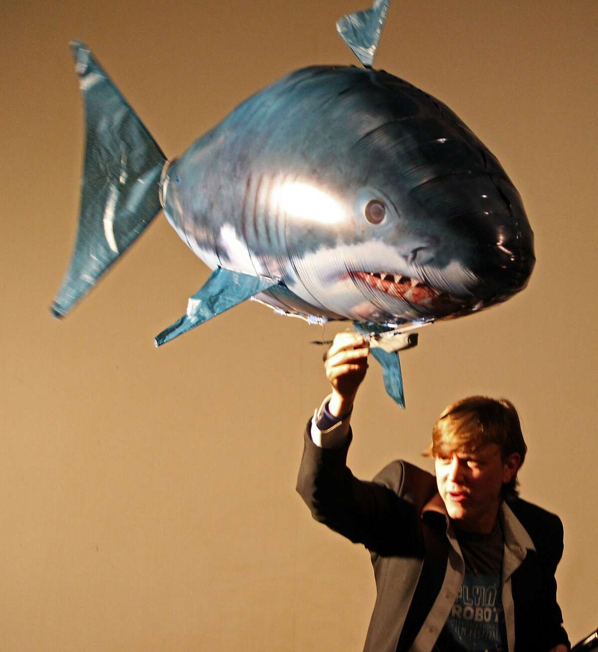 Master of ceremony Justin Hall and the flying shark during the awards ceremony at the1st annual Flying Robot International Film Festival at the Roxie Theater on November 19, 2015.