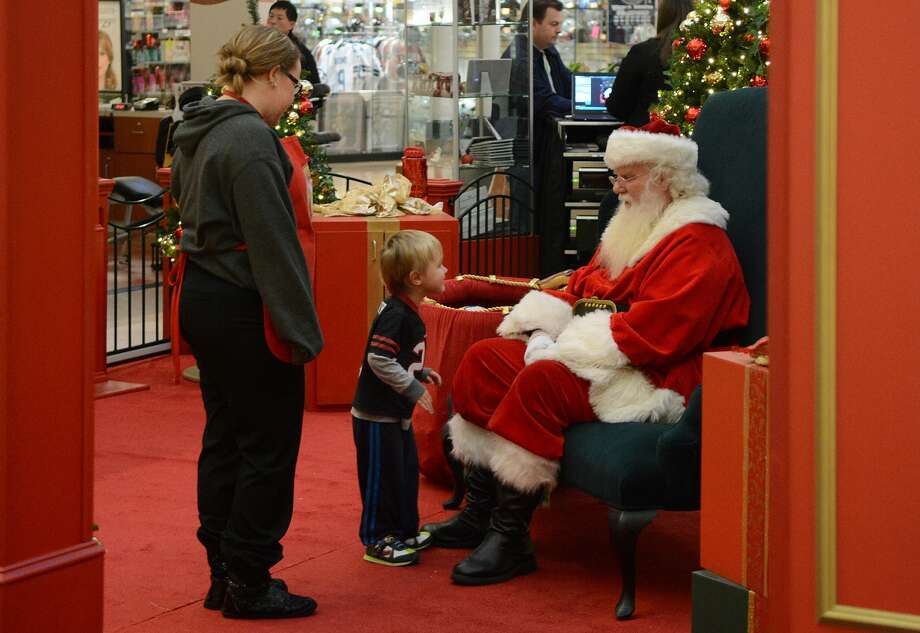 Mattox Mulkey, 3, of Spring, visits with Santa at The Woodlands Mall on Nov. 16th. Photo: Jerry Baker, Freelance