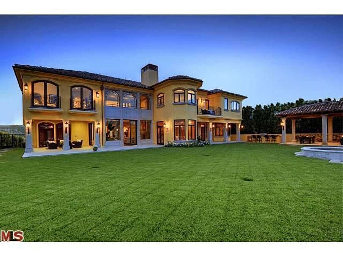 While most honeymooners settle into a cozy, reasonable home when first starting out, Kim and Kanye West bought a sprawling California mansion listed for $11 million in 2013 - one they never lived in and are now selling for $20 million, TMZ reported.