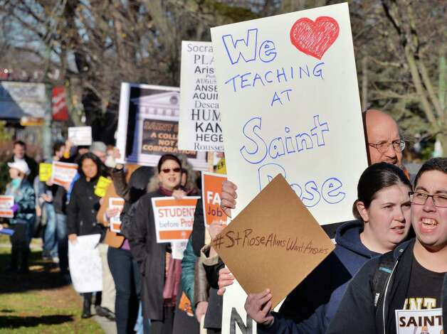Students, alumni and faculty rally in response to proposed cuts to academics and faculty layoffs outside the Saint Rose Administration Building on Madison Ave. Friday Nov. 20, 2015 in Albany, NY.  (John Carl D'Annibale / Times Union) Photo: John Carl D'Annibale / 10034327A