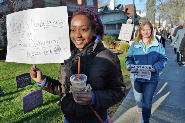Education major Asia Chapman joins students, alumni and faculty members to rally in response to proposed cuts to academics and faculty layoffs outside the Saint Rose Administration Building on Madison Ave. Friday Nov. 20, 2015 in Albany, NY.  (John Carl D'Annibale / Times Union) Photo: John Carl D'Annibale / 10034327A