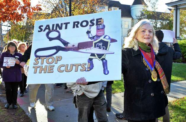 Dr. Hollis Seamon, a St. Rose English professor with 30 years service, joins students, alumni and faculty members to rally in response to proposed cuts to academics and faculty layoffs outside the Saint Rose Administration Building on Madison Ave. Friday Nov. 20, 2015 in Albany, NY.  (John Carl D'Annibale / Times Union) Photo: John Carl D'Annibale / 10034327A