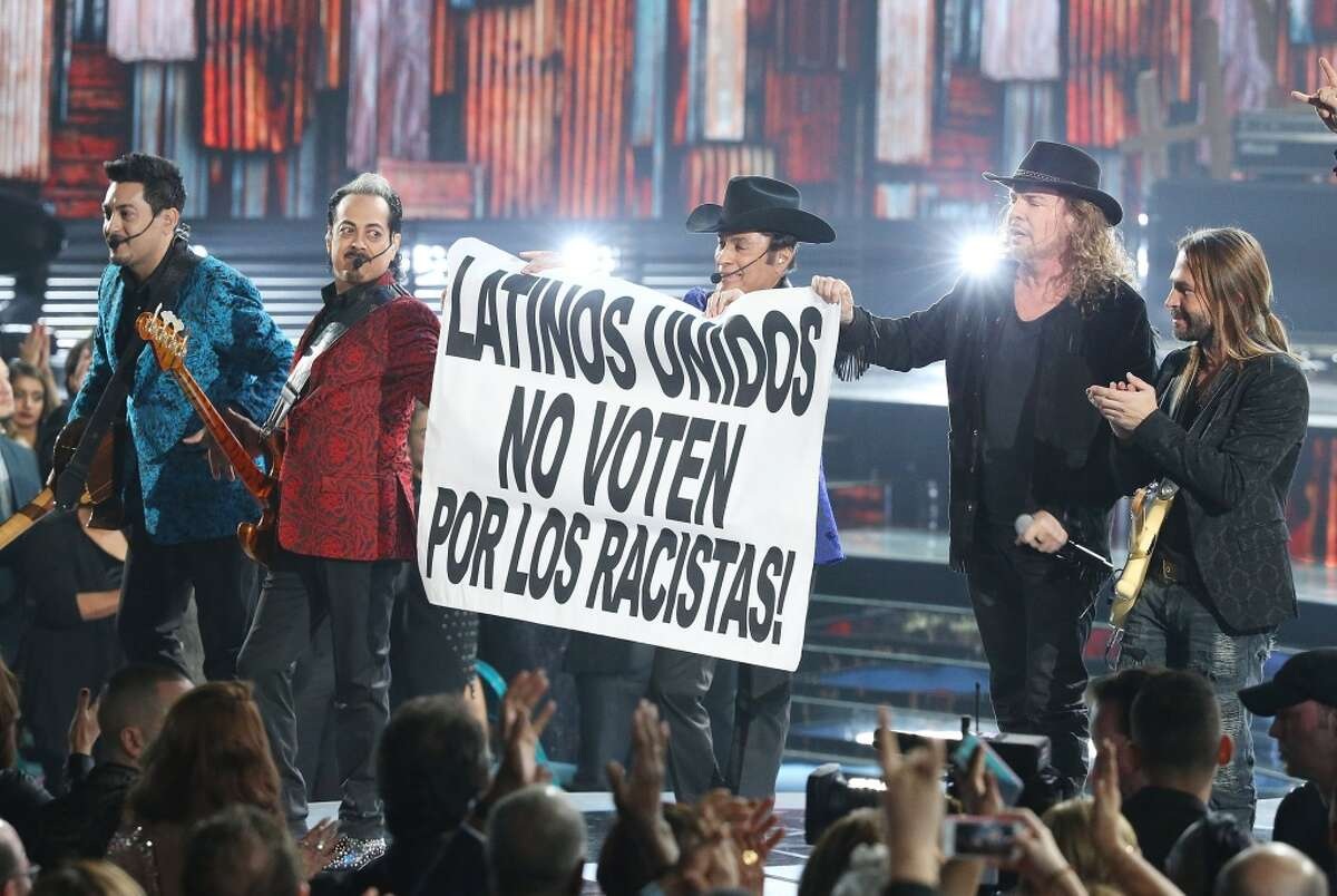 Mana and Los Tigres Del Norte The groups held up a sign that read 'Don't vote for racists!' at the Latin Grammys.