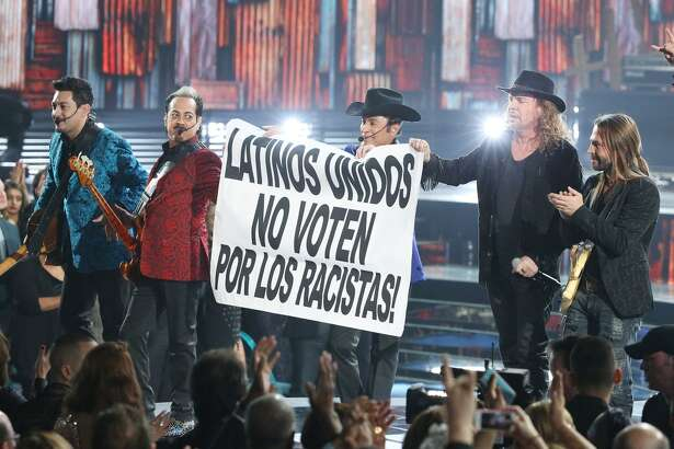 "Members of the music groups Mana and Los Tigres Del Norte perform ""Somos Mas Americans"" onstage during the 16th Latin GRAMMY Awards"