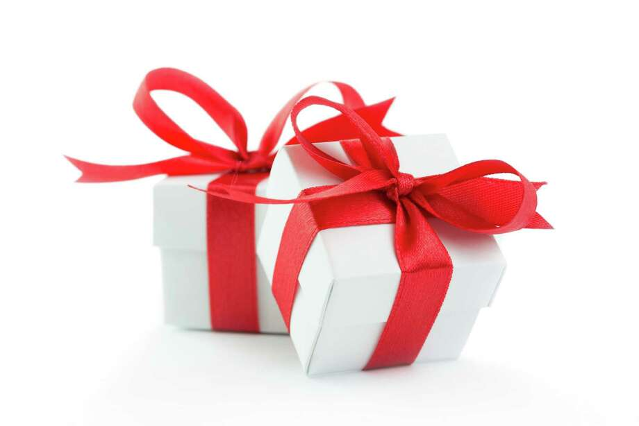Two gift boxes with red ribbons on white background Photo: Fotolia / Kenishirotie - Fotolia
