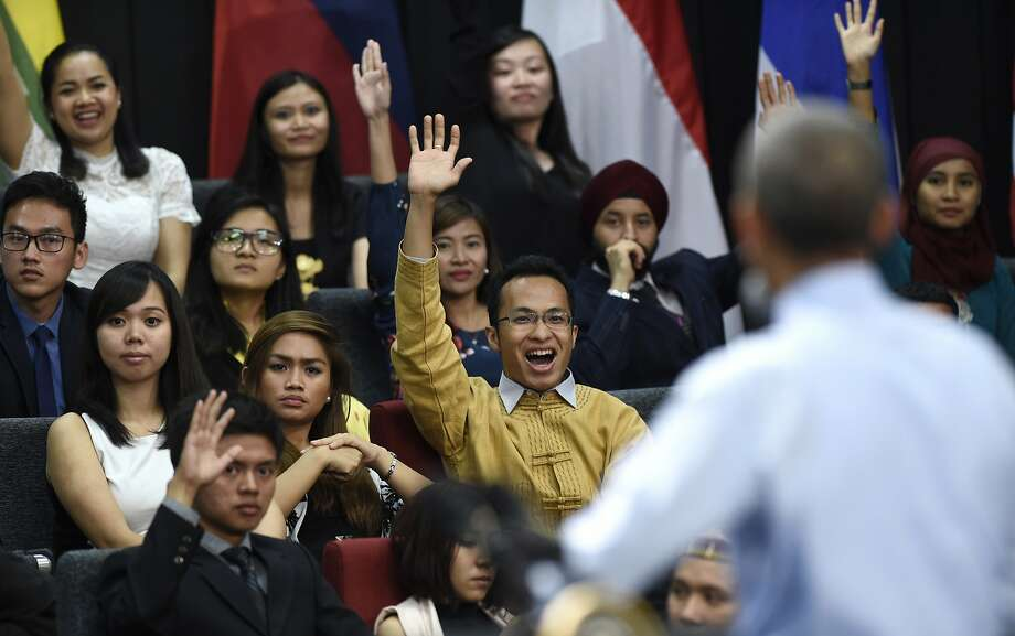 People raise their hand in hopes of asking President Barack Obama a question as he speaks at the Young Southeast Asian Leaders Initiative (YSEALI) town hall at Taylor's University in Kuala Lumpur, Malaysia, Friday, Nov. 20, 2015. (AP Photo/Susan Walsh) Photo: Susan Walsh, Associated Press