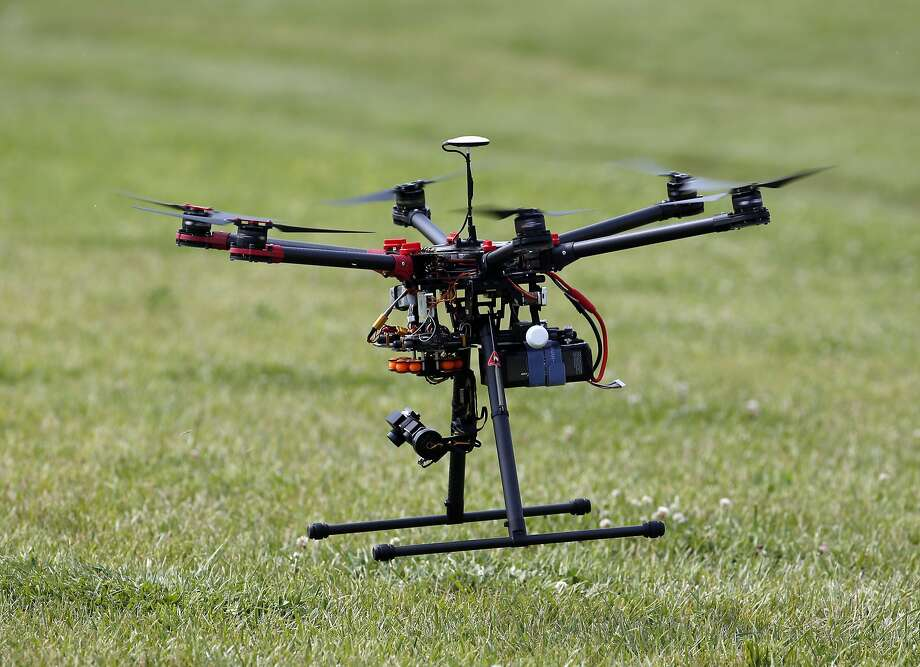 In this photo taken June 11, 2015, a hexacopter drone is flown during a demonstration in Cordova, Md. An aviation industry task force plans to recommend Friday that operators be required to register drones weighing as little as a half of a pound, a threshold that could capture some remote-controlled toys, industry officials said. (AP Photo/Alex Brandon) Photo: Alex Brandon, Associated Press